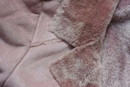 brown suede fabric texture and fur collar on a winter jacket Stockfoto