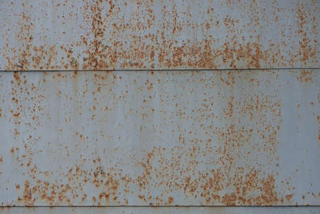 gray metal texture from old brown rusty iron dirty wall and seams