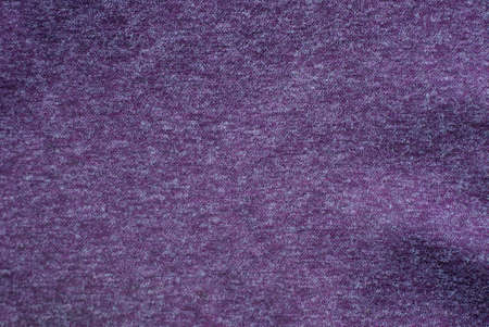 Lilac dark background from a fragment of crumpled cloth clothes