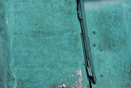 green metal texture from old shabby iron wall in rust with a seam