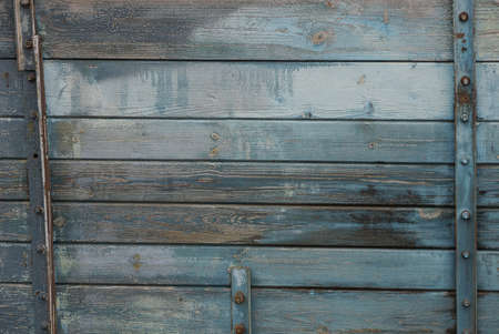 gray blue wooden texture from old shabby planks in the wall with metal plates Stockfoto - 163357563