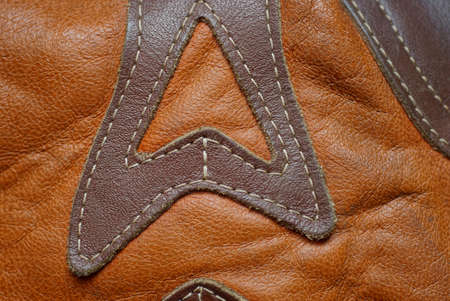 brown leather texture of patches and seams on clothes Stockfoto