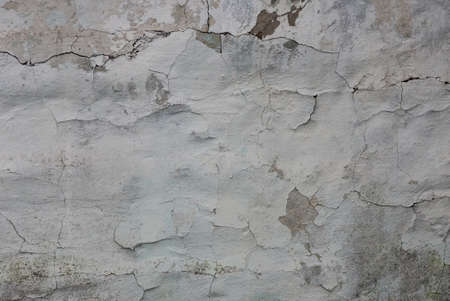 gray white texture of shabby plaster with cracks on an old concrete wall