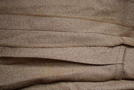 brown gray fabric texture from a crumpled piece of cloth and seams
