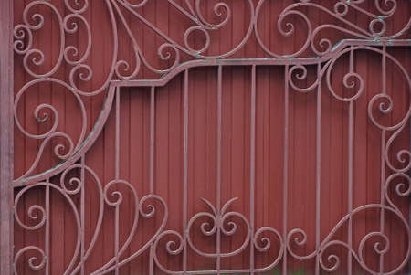 metal texture of a piece of red iron wall with a forged pattern