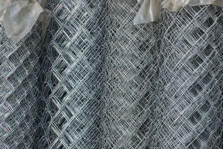 gray metal texture of iron mesh in rolls