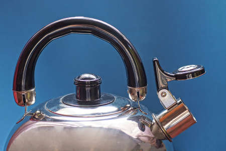 one gray metal kettle with a whistle and a black plastic handle on a blue background