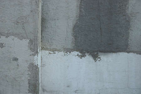 gray stone texture from a dirty concrete wall with a seam