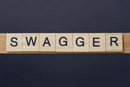 text on word swagger from gray wooden letters on a black background Stockfoto