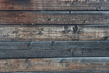gray brown wooden background of a boards in the wall of the fence