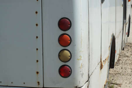 row on a four round headlights on a dirty white metal of a bus car Stock Photo