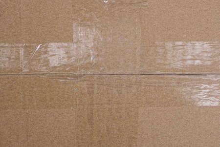 brown paper texture from a piece of crumpled cardboard wrapped and seam