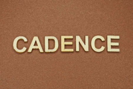 gray word cadence made of wooden letters on brown background Stock Photo