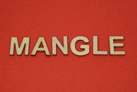 text the word mangle from gray wooden small letters on an red table