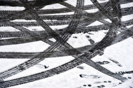 Prints from a car in the melting snow Stock Photo - 9132837