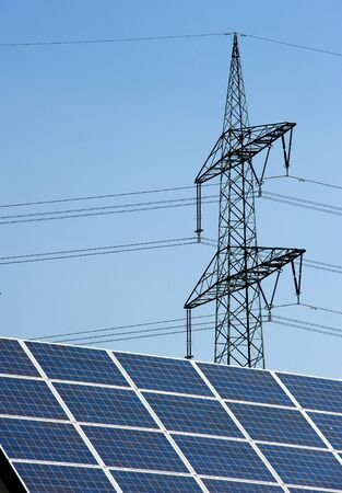 Sun panels on a roof with powercables on the background Stock Photo