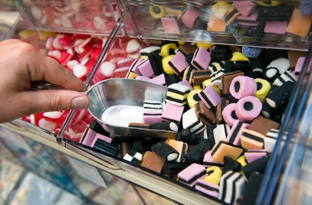 Sweets in a small container in a candy shop Stock Photo
