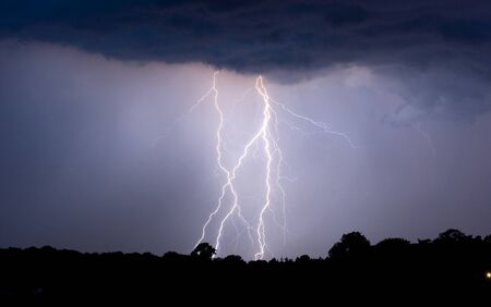 Thunder and lightning at the end of a warm day in the Netherlands photo