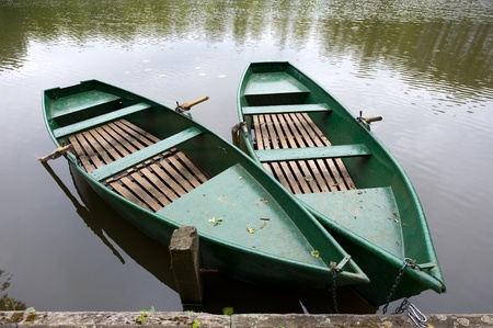 Two rowboats laying in the water of a small lake in the Netherlands photo