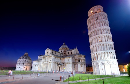 The hanging tower of Pisa and cathedral after sunset photo