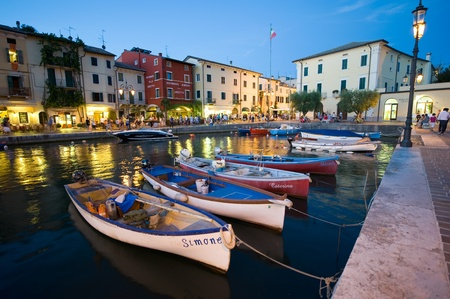 LAZISE - AUG 15: The beautiful and romantic harbor of Lazise at the Lake Garda on August 15, 2011 in Italy. Lazise is one of the most popular cities visited by tourists in the summer. Editorial