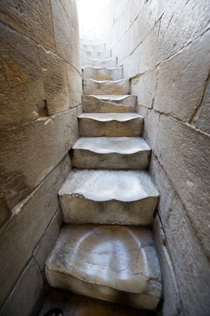 Old marble spiral staircase in the hanging tower of Pisa