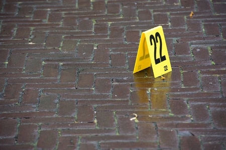 Evidence is marked with a number on a crime scene Stock Photo