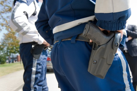 holster: Pistol of a policeman at his holster Stock Photo