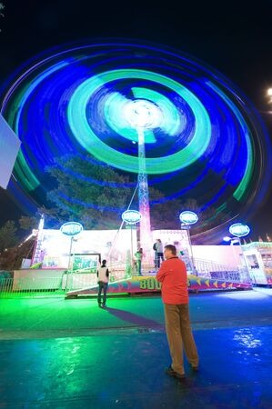 A turning ferris wheel in the evening on an amusement park  Stock Photo - 15950704
