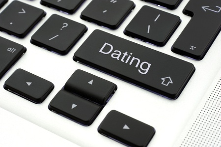 Dating button on the keypad of a laptop