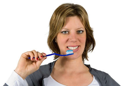 Woman about to brush her teeth Stock Photo - 17497873