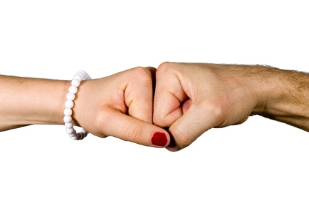 The fist of a woman and a man bumping together Stock Photo - 17558717