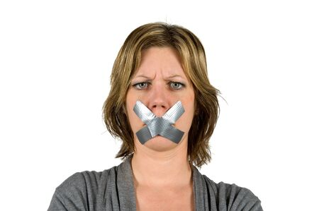 shut: Woman looking angry with her mouth taped
