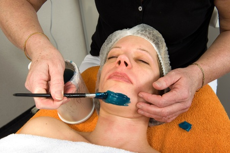 A woman s chin is being waxed in a beauty salon Stock Photo - 17497847