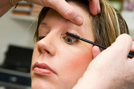 A woman s eyelash is done in a beauty salon photo