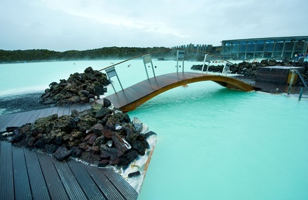 Wooden bridge in the Blue Lagoon geothermal bath resort in Iceland photo