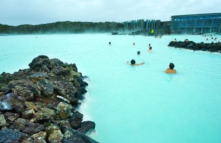 thermal spring: People bathing in the Blue Lagoon geothermal bath resort in Iceland