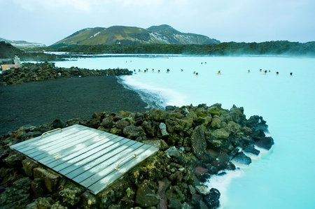 People bathing in the Blue Lagoon geothermal bath resort in Iceland
