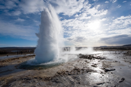 The Strokkur geyser in Iceland is erupting in the winter photo