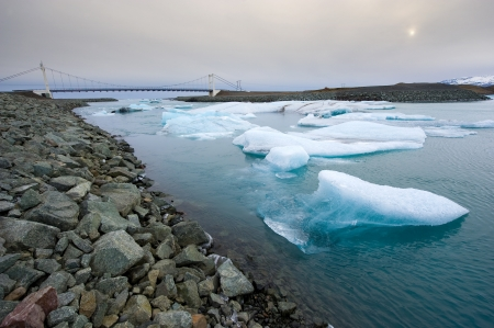 drifting ice: Blue icebergs floating towards the sea in the jokulsarlon lagoon