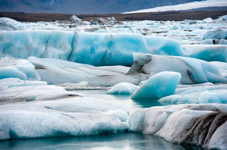 drifting ice: Blue icebergs floating in the jokulsarlon lagoon in Iceland in the winter