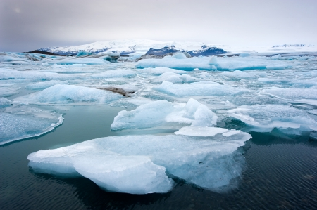 polar climate: Blue icebergs floating in the jokulsarlon lagoon in Iceland in the winter