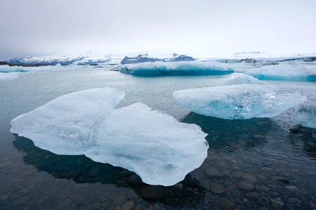 arctic landscape: Blue icebergs floating in the jokulsarlon lagoon in Iceland in the winter