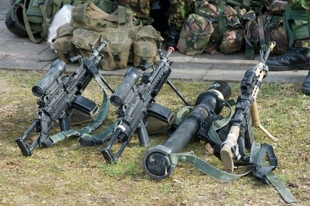 Automatic weapons standing on the ground during a briefing of special forces Stock Photo - 19096656