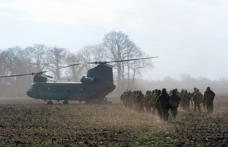 GEESTEREN, NETHERLANDS - MARCH 25: A Dutch Chinook helicopter just landed on a field near a farm to pick up military soldiers during a practise, March 25, 2013. Stock Photo - 19489311