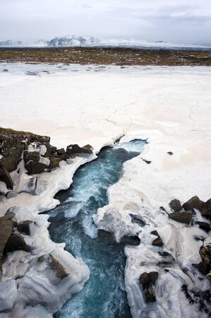 glacial: Waterfall in the winter near pingvellir valley in Iceland.  Stock Photo