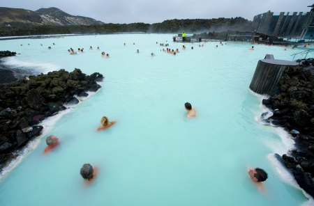 Reykjavik, Iceland - March 08, 2013: People bathing in The Blue Lagoon, a geothermal bath resort in the south of Iceland, a must see by tourists. The water is sourced from a power station nearby. Редакционное
