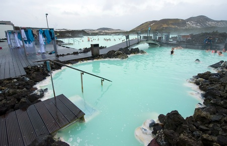 hot spring: Reykjavik, Iceland - March 08, 2013: People bathing in The Blue Lagoon, a geothermal bath resort in the south of Iceland, a must see by tourists. The water is sourced from a power station nearby. Editorial
