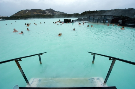 thermal spring: Reykjavik, Iceland - March 08, 2013: People bathing in The Blue Lagoon, a geothermal bath resort in the south of Iceland, a must see by tourists. The water is sourced from a power station nearby. Editorial