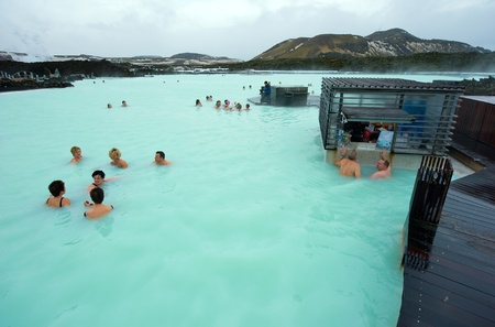 Reykjavik, Iceland - March 08, 2013: People bathing in The Blue Lagoon, a geothermal bath resort in the south of Iceland, a 'must see' by tourists. The water is sourced from a power station nearby.
